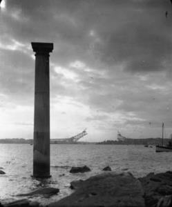 Bradley's Head pilon [once part of] GPO [General Post Office] at high tide [with incomplete Sydney Harbour Bridge in background] [Box 27]