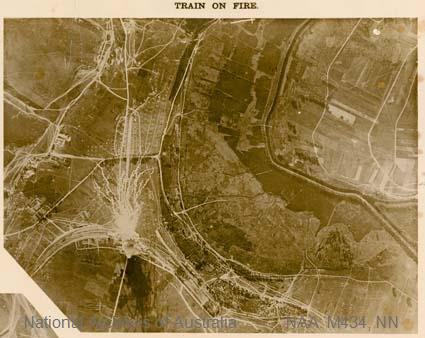 Aerial photographs of particular World War I battles and areas under bombardment.   [Black and white  Print - sub item -Train on fire].