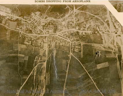 Aerial photographs of particular World War I battles and areas under bombardment.   [Black and white  Print - sub item - Bombs dropping from aeroplane].
