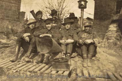Records of Major Richard Victor Morse DSO (Distinguished Service Order) - World War I - Photograph of seven soldiers behind a gramophone